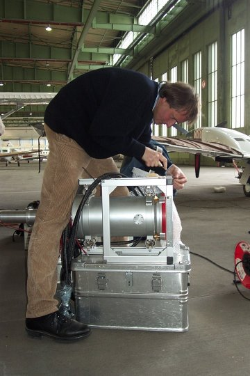 The engineer Meinhard Seefeldner preparing the telescope mount for integration into the Cessna.